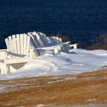 image of chairs on beach with snow