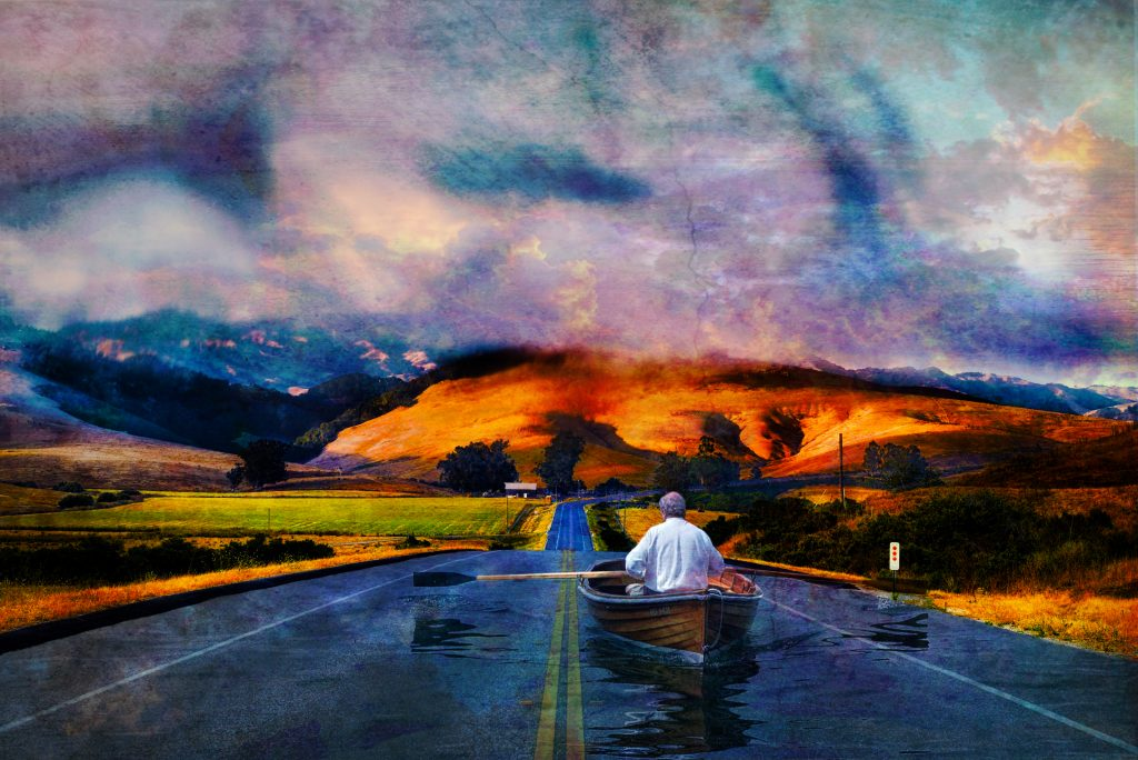 composit image of man rowing boat in a road